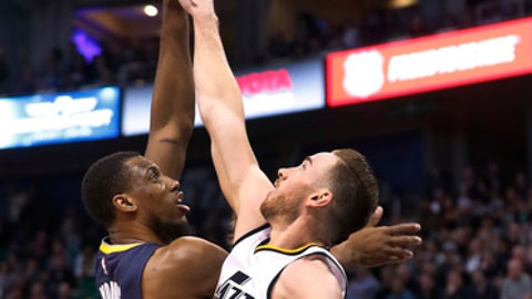 Utah Jazz forward Gordon Hayward (20) tries to block the shot of Indiana Pacers forward Thaddeus Young (21) during the first half of an NBA basketball game, Saturday, Jan. 21, 2017, in Salt Lake City. (AP Photo/George Frey)
