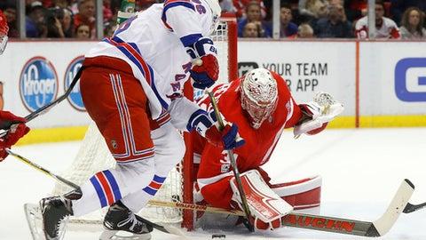 Detroit Red Wings goalie Jared Coreau (31) stops a New York Rangers' Brady Skjei (76) shot in the third period of an NHL hockey game Sunday, Jan. 22, 2017, in Detroit. (AP Photo/Paul Sancya)