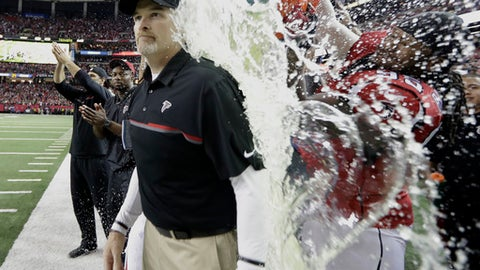 Atlanta Falcons head coach Dan Quinn is dunked during the second half of the NFL football NFC championship game against the Green Bay Packers, Sunday, Jan. 22, 2017, in Atlanta. The Falcons won 44-21 to advance to Super Bowl LI. (AP Photo/David J. Phillip)