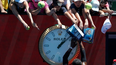 United States' Serena Williams signs autographs after defeating Barbora Strycova of the Czech Republic in their fourth round match at the Australian Open tennis championships in Melbourne, Australia, Monday, Jan. 23, 2017. (AP Photo/Kin Cheung)