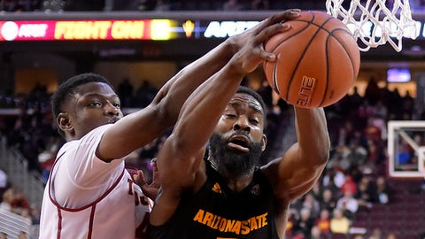 Southern California forward Chimezie Metu, left, and Arizona State forward Obinna Oleka reach for a rebound during the first half of an NCAA college basketball game, Sunday, Jan. 22, 2017, in Los Angeles. (AP Photo/Mark J. Terrill)