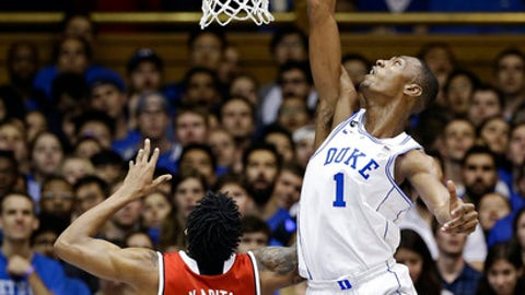 Duke's Harry Giles (1) tries to block North Carolina State's Ted Kapita (23) during the first half of an NCAA college basketball game in Durham, N.C., Monday, Jan. 23, 2017. (AP Photo/Gerry Broome)