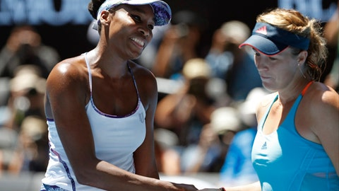 United States' Venus Williams, left, is congratulated by Russia's Anastasia Pavlyuchenkova following her win at their quarterfinal at the Australian Open tennis championships in Melbourne, Australia, Tuesday, Jan. 24, 2017. (AP Photo/Dita Alangkara)