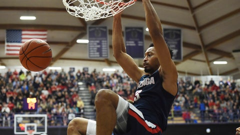 Gonzaga forward Johnathan Williams dunks the ball during the first half of an NCAA college basketball game against the Portland in Portland, Ore., Monday, Jan. 23, 2017. (AP Photo/Steve Dykes)