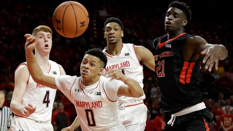 Maryland's Kevin Huerter, Anthony Cowan and Justin Jackson, from left, look for a rebound in front of Rutgers forward Candido Sa, right, during the first half of an NCAA college basketball game, Tuesday, Jan. 24, 2017, in College Park, Md. (AP Photo/Patrick Semansky)