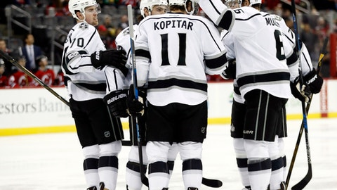 Los Angeles Kings players celebrate a goal by Anze Kopitar (11), of Slovenia, against the New Jersey Devils during the first period of an NHL hockey game, Tuesday, Jan. 24, 2017, in Newark, N.J. (AP Photo/Julio Cortez)
