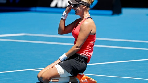Croatia's Mirjana Lucic-Baroni celebrates after defeating Karolina Pliskova of the Czech Republic during their quarterfinal at the Australian Open tennis championships in Melbourne, Australia, Wednesday, Jan. 25, 2017. (AP Photo/Dita Alangkara)