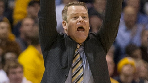 Marquette's head coach Steve Wojciechowski yells out a play against Villanova during the second half of an NCAA college basketball game, Tuesday, Jan. 24, 2017, in Milwaukee. (AP Photo/Tom Lynn)