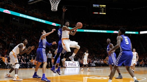Tennessee guard Robert Hubbs III (3) goes for a shot past Kentucky forward Wenyen Gabriel (32) during the first half of an NCAA college basketball game Tuesday, Jan. 24, 2017, in Knoxville, Tenn. (AP Photo/Wade Payne)