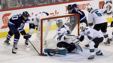 Winnipeg Jets right wing Joel Armia (40) has his wraparound attempt stopped by San Jose Sharks goalie Aaron Dell (30) during the third period of an NHL hockey game Tuesday, Jan. 24, 2017, in Winnipeg, Manitoba. (Trevor Hagan/The Canadian Press via AP)