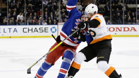 Philadelphia Flyers' Radko Gudas (3) and New York Rangers' Mika Zibanejad (93) compete for control of the puck during the second period of an NHL hockey game Wednesday, Jan. 25, 2017, in New York. (AP Photo/Frank Franklin II)