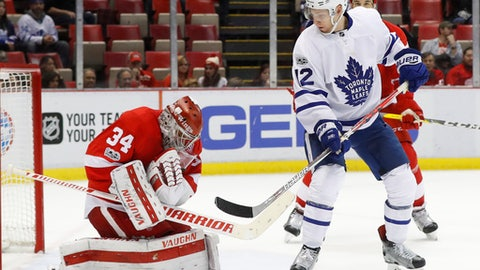 Detroit Red Wings goalie Petr Mrazek (34) stops a shot as Toronto Maple Leafs right wing Connor Brown (12) waits for a rebound during the third period of an NHL hockey game Wednesday, Jan. 25, 2017, in Detroit. Toronto won 4-0. (AP Photo/Paul Sancya)