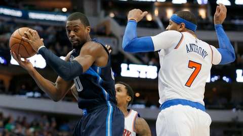 Dallas Mavericks forward Harrison Barnes (40) comes down with an offensive rebound in front of New York Knicks' Carmelo Anthony (7) in the second half of an NBA basketball game, Wednesday, Jan. 25, 2017, in Dallas. (AP Photo/Tony Gutierrez)