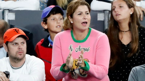 Mirka Federer cheers on husband Roger of Switzerland during his semifinal against compatriot Stan Wawrinka at the Australian Open tennis championships in Melbourne, Australia, Thursday, Jan. 26, 2017. (AP Photo/Dita Alangkara)