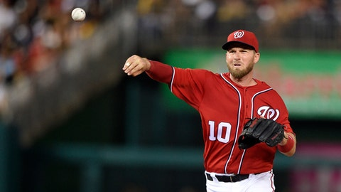 In this photo taken July 16, 2016, Washington Nationals second baseman Stephen Drew (10) throws to first during a baseball game against the Pittsburgh Pirates in Washington. The Nationals and Drew agreed on a one-year contract, with Drew returning for a second season with the Nationals. (AP Photo/Nick Wass)