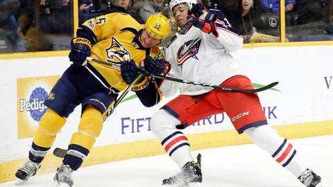 Nashville Predators left wing Cody McLeod (55) and Columbus Blue Jackets defenseman Seth Jones (3) fight for the puck during the second period of an NHL hockey game Thursday, Jan. 26, 2017, in Nashville, Tenn. (AP Photo/Mark Humphrey)