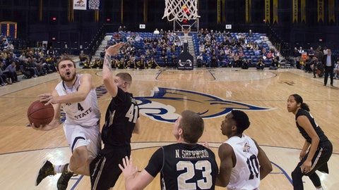 In this photo provided by Montana State University, Montana State forward Sam Neumann (4) jumps for a shot against Idaho during the first half of an NCAA college basketball game, Thursday, Jan. 26, 2017, in Bozeman, Mont. (Kelly Gorham/Montana State University via AP)