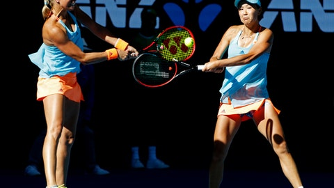 Andrea Hlavackova, left, of the Czech Republic and partner Peng Shuai of China hit a return during the women's doubles final against Bethanie Mattek-Sands of the U.S. and Lucie Safarova of the Czech Republic at the Australian Open tennis championships in Melbourne, Australia, Friday, Jan. 27, 2017. (AP Photo/Dita Alangkara)