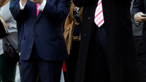FILE - In this Oct. 21, 2012 file photo, New England Patriots owner Robert Kraft, left, and businessman Donald Trump, right, applaud on the field before an NFL football game between the Patriots and the New York Jets in Foxborough, Mass. In the six New England states that voted for Hillary Clinton, some Patriots fans are trying to reconcile their team allegiance with their distaste for Republican President Trump. The New York billionaire has made it no secret he's good friends with team owner Robert Kraft, head coach Bill Belichick and quarterback Tom Brady. New England faces the Atlanta Falcons in the Super Bowl on Feb. 5, 2017, in Houston. (AP Photo/Charles Krupa, File)