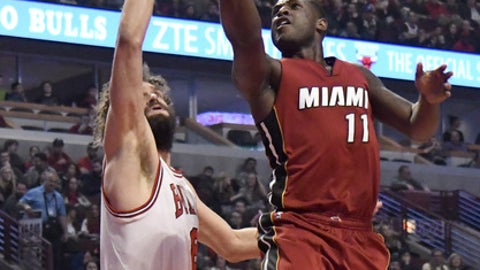 Miami Heat guard Dion Waiters (11) shoots against Chicago Bulls center Robin Lopez (8) during the first half of an NBA basketball game in Chicago, Friday, Jan. 27, 2017. (AP Photo/David Banks)
