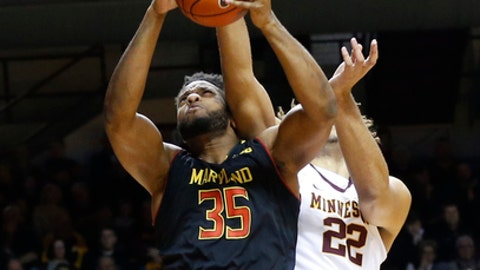 Maryland's Damonte Dodd, left, pulls in a rebound as Minnesota's Reggie Lynch defends during the first half of an NCAA college basketball game Saturday, Jan. 28, 2017, in Minneapolis. (AP Photo/Jim Mone)