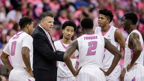 Creighton coach Greg McDermott talks to his players Marcus Foster (0), Davion Mintz (1), Khyri Thomas (2), Justin Patton, second right, and Cole Huff, right, during the second half of an NCAA college basketball game against DePaul in Omaha, Neb., Saturday, Jan. 28, 2017. Creighton won 83-66. (AP Photo/Nati Harnik)