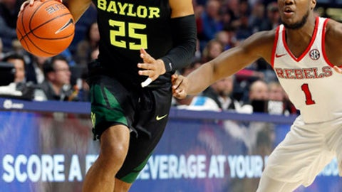 Baylor guard Al Freeman (25) dribbles past Mississippi guard Deandre Burnett (1) in the second half of an NCAA college basketball game in Oxford, Miss., Saturday, Jan. 28, 2017. Baylor won 78-75. (AP Photo/Rogelio V. Solis)