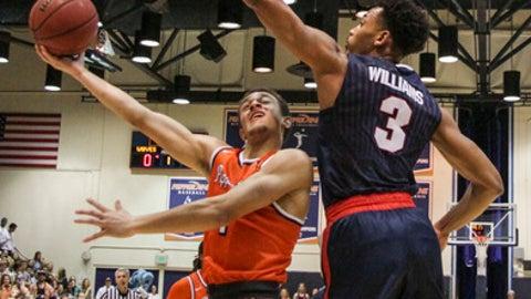 Pepperdine guard Elijah Lee shoots against Gonzaga guard Johnathan Williams during the first half of an NCAA college basketball game Saturday, Jan. 28, 2017, in Malibu, Calif.. (AP Photo/Ringo H.W. Chiu)
