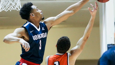 Gonzaga guard Johnathan Williams, left, blocks a shot by Pepperdine guard Elijah Lee during the first half of an NCAA college basketball game Saturday, Jan. 28, 2017, in Malibu, Calif.. (AP Photo/Ringo H.W. Chiu)