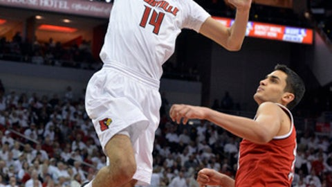 Louisville's Anas Mahmoud (14) goes up for a dunk past the defense of North Carolina State's Omer Yurtseven (14) during the second half of an NCAA college basketball game, Sunday, Jan. 29, 2017, in Louisville, Ky. Louisville won 85-60. (AP Photo/Timothy D. Easley)