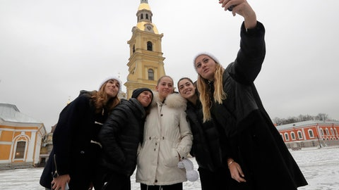 From left: tennis players Alize Cornet of France, Roberta Vinci of Italy, Jelena Ostapenko of Latvia, Ana Konjuh of Croatia and Kristina Mladenovic of France, participants of the St. Petersburg Ladies Trophy-2017 tennis tournament, make a selfie photo together in Saint Peter and Paul Fortress in St.Petersburg, Russia, Monday, Jan. 30, 2017.  St. Petersburg Ladies Trophy-2017 tennis tournament starts on Monday and will end Sunday, Feb. 5 finale. (AP Photo/Dmitri Lovetsky)