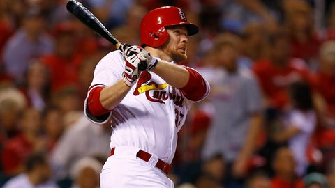 St. Louis Cardinals' Brandon Moss watches his two-run home run during the sixth inning of a baseball game against the Pittsburgh Pirates, Friday, Sept. 30, 2016, in St. Louis. (AP Photo/Billy Hurst)