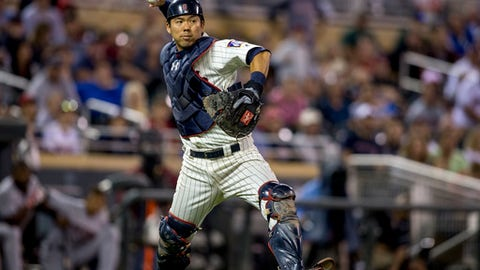 This Sept. 10, 2016 photo shows Minnesota Twins catcher Kurt Suzuki fielding a ball in the ninth inning of a baseball game in Minneapolis. Suzuki and the Atlanta Braves finalized their $1.5 million, one-year contract, giving the team another experienced catcher to share time with Tyler Flowers. The agreement was announced by the team on Monday, Jan. 30, 2016 after Suzuki passed his physical. (AP Photo/Bruce Kluckhohn)