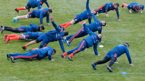 France's rugby players warm up during a training session at the National Rugby Center in Marcoussis, south of Paris, Tuesday, Jan. 31 ,2017. France will play against England during their Six Nations tournament match at Twickenham Stadium on Saturday, Feb. 4. (AP Photo/Michel Euler)