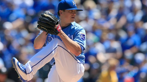 FILE - In this May 4, 2016, file photo, Kansas City Royals starting pitcher Kris Medlen delivers to a Washington Nationals batter during the first inning of a baseball game at Kauffman Stadium in Kansas City, Mo. Medlen has agreed to a minor league contract with the Atlanta Braves as he attempts to revive his career with his original team. The 31-year-old would get a $1 million, one-year contract if added to the 40-man roster as part of the deal the team confirmed Tuesday, Jan. 31, 2017. (AP Photo/Orlin Wagner, File)