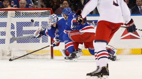 The puck shot by Columbus Blue Jackets left wing Nick Foligno, not seen, gets past New York Rangers goalie Antti Raanta for a goal during the second period of an NHL hockey game, Tuesday, Jan. 31, 2017, in New York. (AP Photo/Julie Jacobson)