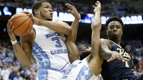 North Carolina's Kennedy Meeks (3) and Joel Berry II (2) struggle for a rebound with Pittsburgh's Jamel Artis (1) during the second half of an NCAA college basketball game in Chapel Hill, N.C., Tuesday, Jan. 31, 2017. North Carolina won 80-78. (AP Photo/Gerry Broome)