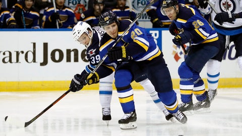 St. Louis Blues' Alexander Steen (20) and Winnipeg Jets' Toby Enstrom, of Sweden, (39) chase after a loose puck as Blues' Paul Stastny (26) watches during the second period of an NHL hockey game Tuesday, Jan. 31, 2017, in St. Louis. (AP Photo/Jeff Roberson)