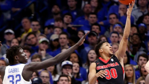 Georgia's J.J. Frazier (30) shoots near the defense of Kentucky's Wenyen Gabriel (32) during the first half of an NCAA college basketball game, Tuesday, Jan. 31, 2017, in Lexington, Ky. (AP Photo/James Crisp)