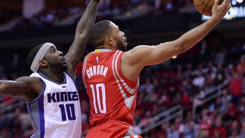 Houston Rockets guard Eric Gordon, right, shoots against Sacramento Kings guard Ty Lawson during the first half of an NBA basketball game Tuesday, Jan. 31, 2017, in Houston. (AP Photo/George Bridges)