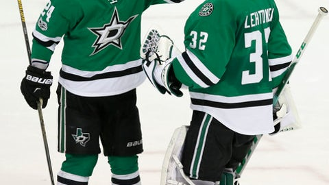 Dallas Stars defenseman Jordie Benn (24) and goalie Kari Lehtonen (32) celebrate after the team's NHL hockey game against the Toronto Maple Leafs in Dallas, Tuesday, Jan. 31, 2017. (AP Photo/LM Otero)