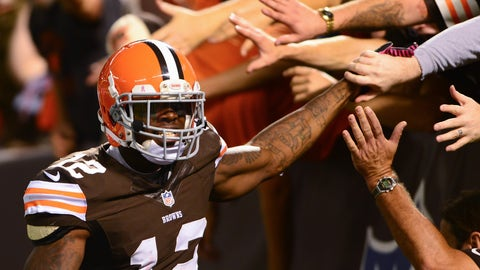 Oct 3, 2013; Cleveland, OH, USA; Cleveland Browns wide receiver Josh Gordon (12) celebrates with fans after catching a pass for a touchdown during the third quarter against the Buffalo Bills at FirstEnergy Stadium. Mandatory Credit: Andrew Weber-USA TODAY Sports