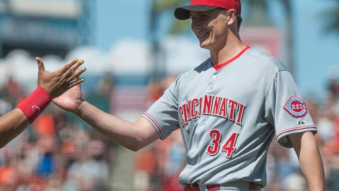 Jun 29, 2014; San Francisco, CA, USA; Cincinnati Reds starting pitcher Homer Bailey (34) smiles after pitching a complete game shutout against the San Francisco Giants at AT&T Park. The Reds won 4-0. Mandatory Credit: Ed Szczepanski-USA TODAY Sports