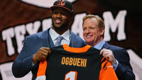 Apr 30, 2015; Chicago, IL, USA; Cedric Ogbuehi (Texas A&M) poses for a photo with NFL commissioner Roger Goodell after being selected as the number 21st overall pick to the Cincinnati Bengals in the first round of the 2015 NFL Draft at the Auditorium Theatre of Roosevelt University. Mandatory Credit: Dennis Wierzbicki-USA TODAY Sports