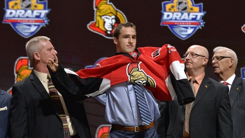 Jun 26, 2015; Sunrise, FL, USA; Colin White puts on a team jersey after being selected as the number twenty-one overall pick to the Ottawa Senators in the first round of the 2015 NHL Draft at BB&T Center. Mandatory Credit: Steve Mitchell-USA TODAY Sports