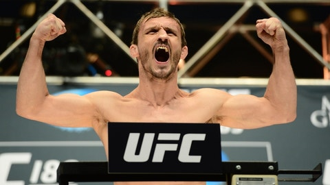 Jul 10, 2015; Las Vegas, NV, USA; Brad Pickett weighs in for his bout against Thomas Almeida (not pictured) during weigh-ins for UFC 189 at MGM Grand Garden Arena. Mandatory Credit: Joe Camporeale-USA TODAY Sports