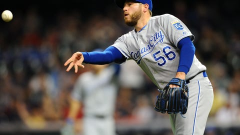 Sep 15, 2015; Cleveland, OH, USA; Kansas City Royals relief pitcher Greg Holland (56) flips the ball to third base to make a force out during the ninth inning against the Cleveland Indians at Progressive Field. The Royals won 2-0. Mandatory Credit: Ken Blaze-USA TODAY Sports