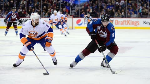Dec 17, 2015; Denver, CO, USA; Colorado Avalanche center Matt Duchene (9) controls the puck away from New York Islanders defenseman Nick Leddy (2) in the second period at the Pepsi Center. Mandatory Credit: Ron Chenoy-USA TODAY Sports