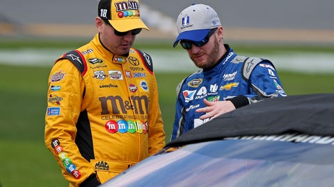 Feb 14, 2016; Daytona Beach, FL, USA; NASCAR Sprint Cup Series driver Dale Earnhardt Jr. (88) and NASCAR Sprint Cup Series driver Kyle Busch (18) talk during qualifying for the Daytona 500 at Daytona International Speedway. Mandatory Credit: Peter Casey-USA TODAY Sports