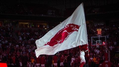 Feb 20, 2016; Fayetteville, AR, USA; Arkansas Razorbacks mascot Big Red waves the Razorback flag before the start of a game with the Missouri Tigers at Bud Walton Arena. The Razorbacks won 84-72. Mandatory Credit: Gunnar Rathbun-USA TODAY Sports